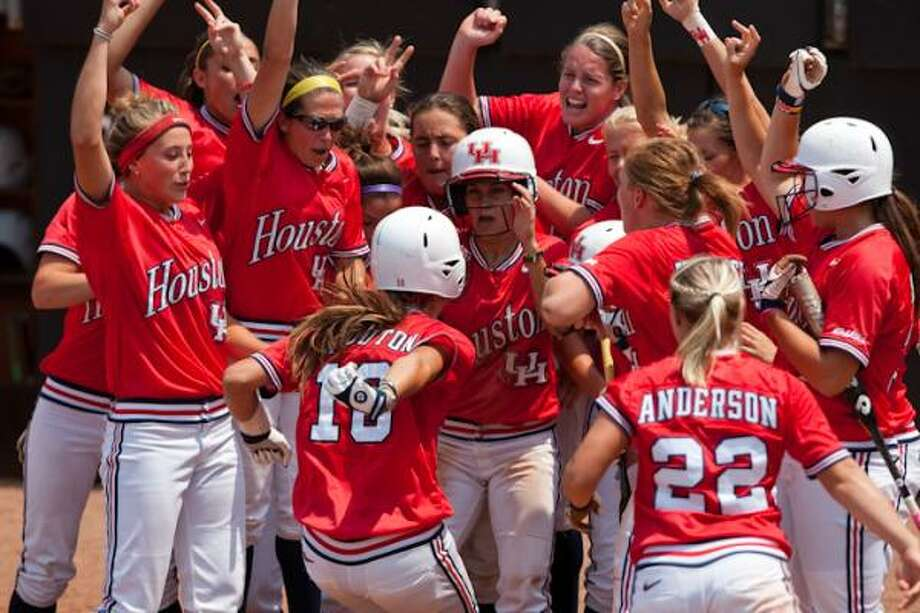 Catcher Haley Outon, center, crosses the plate after her second home run of the day. Photo: UH Athletics