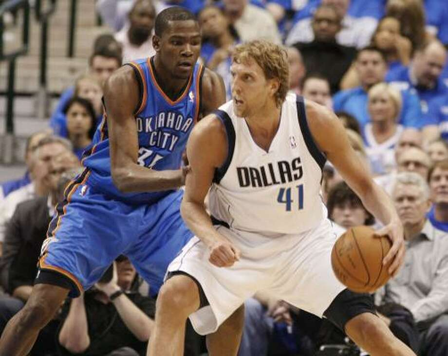 As Kevin Durant and Dirk Nowitzki dueled, there seemed to be something else significant about the way they excel. Photo: Paul Moseley, McClatchy-Tribune