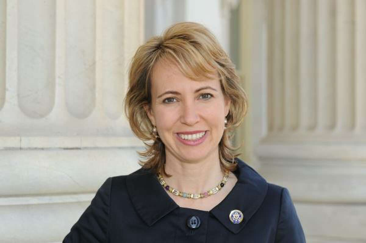 Rep. Gabrielle Giffords, shown in a March photo, showed improvement after procedures to remove a ventilator were successful Sunday.