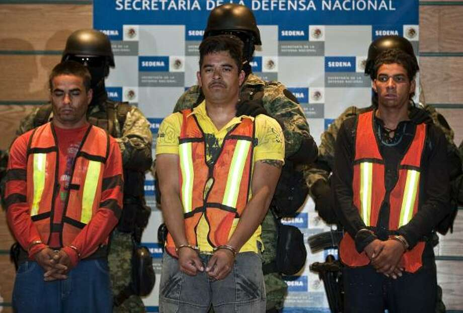 "Julian Zapata Espinoza, center, known as ""Tweety Bird,"" is presented Wednesday in Mexico City with other alleged members of the Zetas held in the slaying of U.S. Special Agent Jaime Zapata. Photo: Ronaldo Schemidt, AFP/Getty Images"