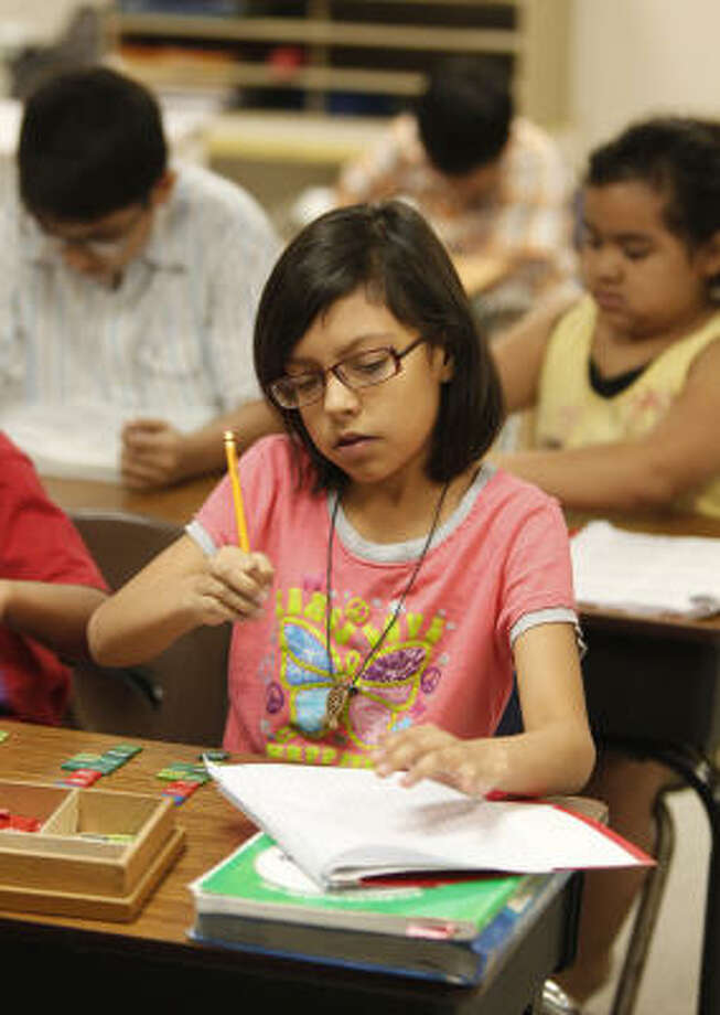 Yamilet Hernandez, 9, tends to her studies recently at Alief Montessori Community School, which is rated among the 10 best elementary schools in the area. Photo: Melissa Phillip, Chronicle