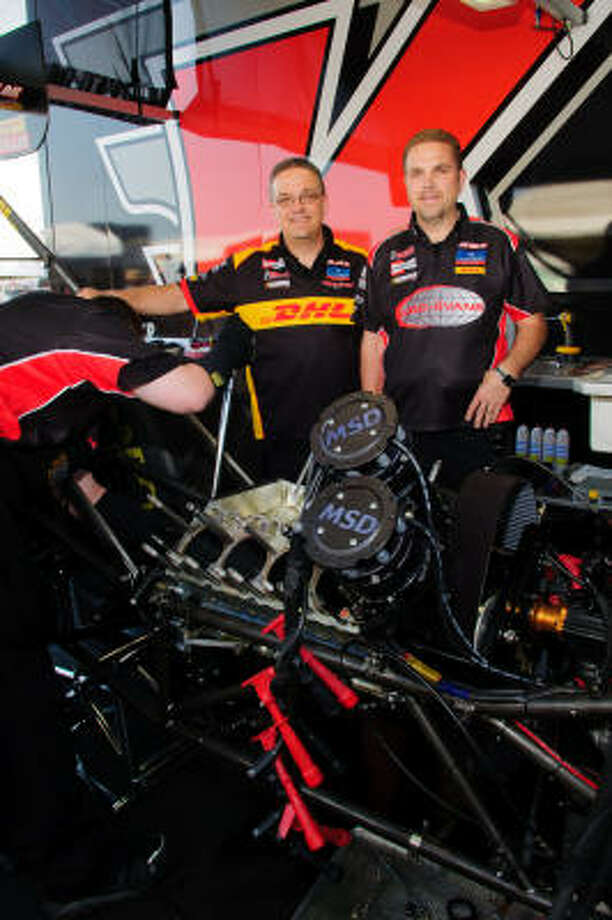Kalitta Motorsports crew members Jon Oberhofer, left, and brother Jim, who grew up in the Dallas area, are back in Texas for this weekend's O'Reilly Auto Parts NHRA Spring Nationals. Photo: Kim Christensen, For The Chronicle