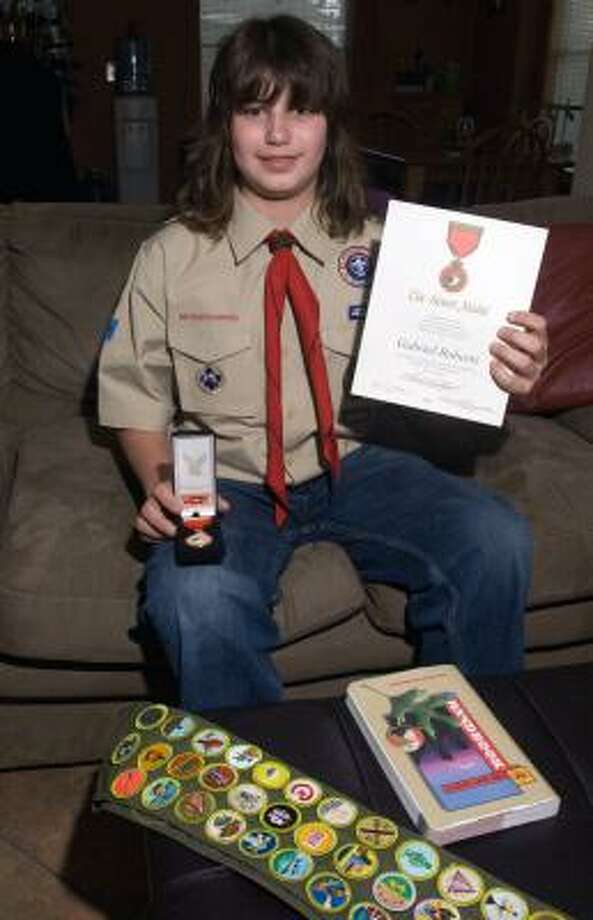 AWARD-WINNING SCOUT: Thirteen-year-old Cypress resident Gabe Roberts won a top honor with the Boy Scouts of America for saving someone's life while putting his own in danger. He has earned a number of awards from the Boy Scouts of America. Photo: Eddy Matchette, FOR THE CHRONICLE
