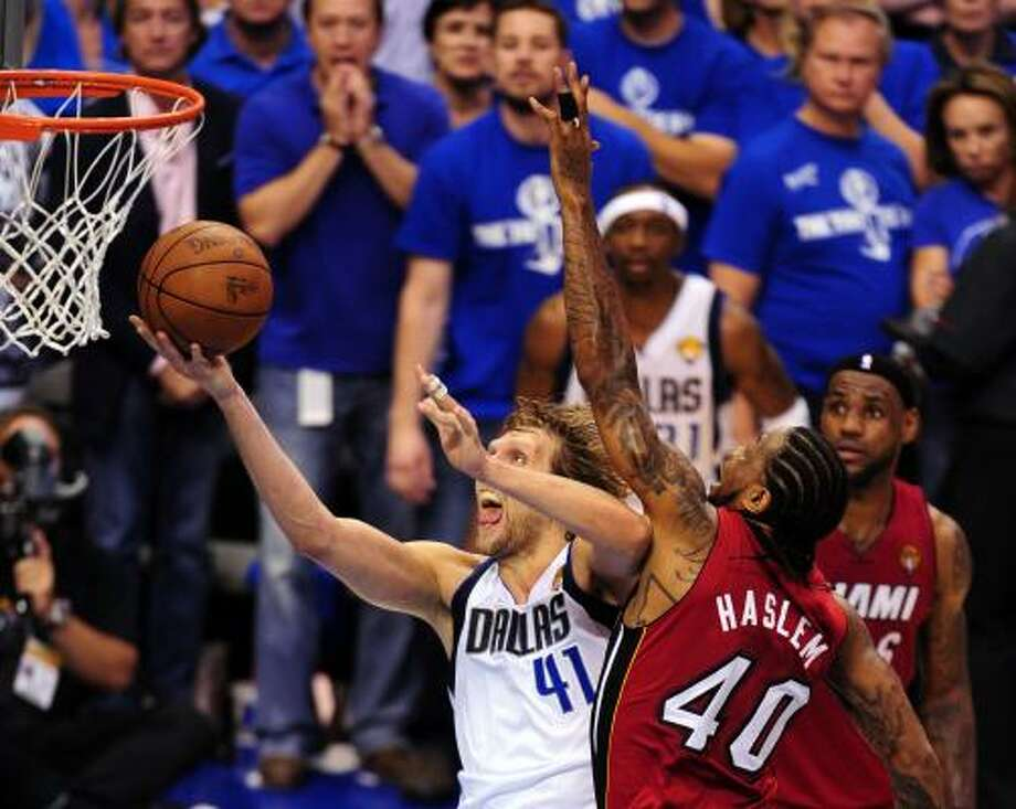 Dirk Nowitzki turned himself into a tougher assignment for defenders such as Udonis Haslem, right. Photo: MARK RALSTON, Getty