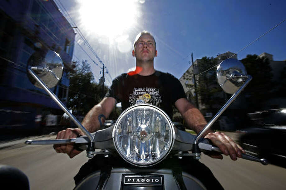 "Keith Taylor, sales manager of a dealership called Scoot, says climbing fuel prices are ""a pretty huge deal"" for his line of work. Photo: Johnny Hanson :, Chronicle"