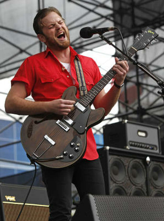 Kings of Leon frontman Caleb Followill lead the group through their hits and some lesser-known tunes. Photo: Melissa Phillip, Chronicle