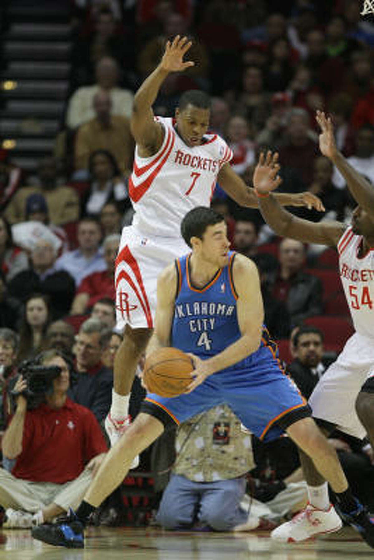Rockets guard Kyle Lowry (7) and forward Patrick Patterson (54) try to keep Thunder forward Nick Collison from making a pass.