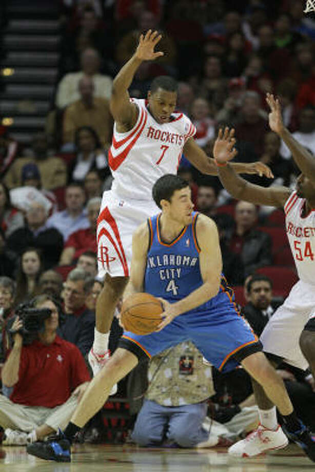 Rockets guard Kyle Lowry (7) and forward Patrick Patterson (54) try to keep Thunder forward Nick Collison from making a pass. Photo: Karen Warren, Chronicle