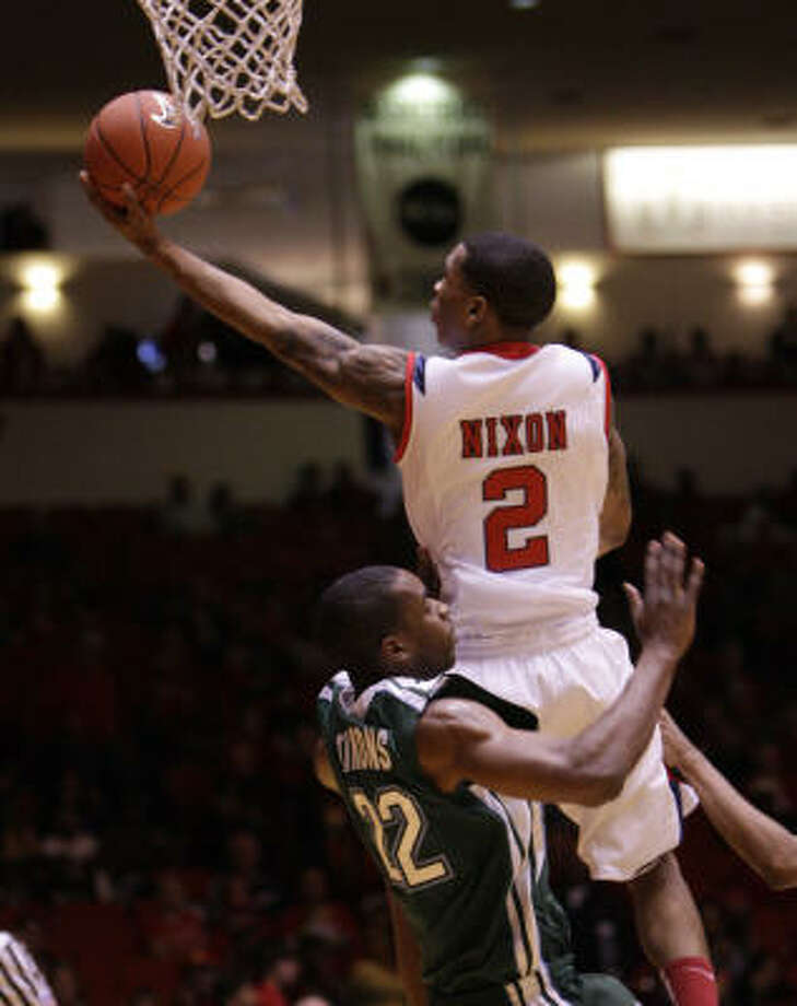 UH guard Zamal Nixon looks to score two of his team-high 17 points in Saturday's win. Photo: Bob Levey, For The Chronicle
