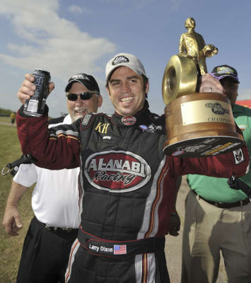 Larry Dixon, above celebrating his Top Fuel title at the 2010 O'Reilly Spring Nationals, is back this weekend. Photo: Jere Foss, AP