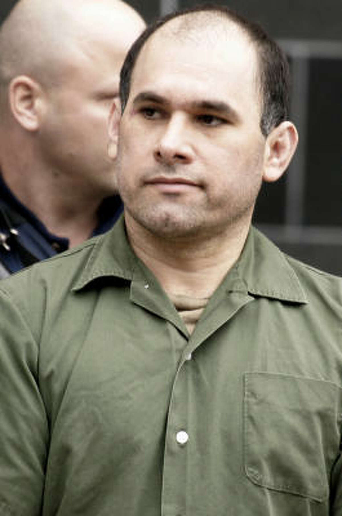 Osiel Cardenas-Guillen, 39, the accused Mexican drug kingpin extradited to the United States last month, leaves the federal courthouse in Houston after pleading not guilty Friday, Feb. 9, 2007, to charges connected to running a cartel that at its height smuggled four to six tons of cocaine per month into the country.