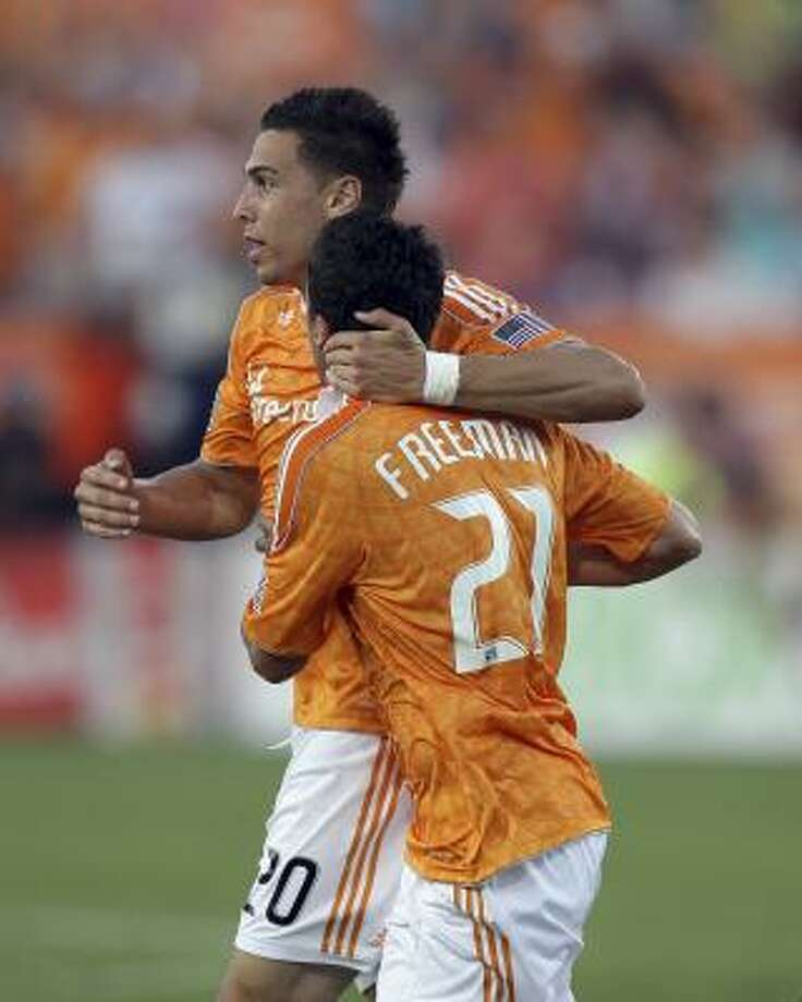 Dynamo players Geoff Cameron, left, and Hunter Freeman celebrate after a goal in the first half on Saturday. Photo: Bob Levey, Getty