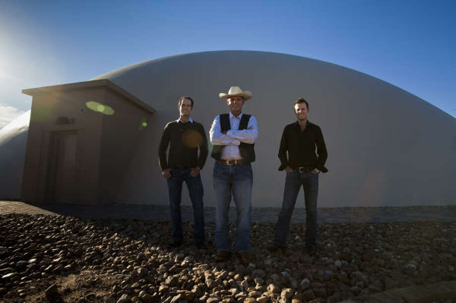 John Fedele, left, his father, Peter, and brother Ken held a grand opening late last month for their unusual structure in Sealy. Their company, ABC Domes, has been impressed with Sealy's pro-growth attitude, and the company declined tax abatements. It plans to build two more domes on the site. Photo: Eric Kayne, Chronicle