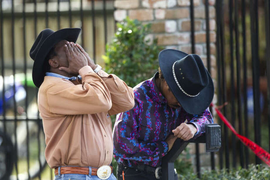 "Anthony Sanders, left, and Oliver ""Tony"" Sanders, husband of one of the two women who perished in a deadly three-alarm fire, react as the last of the two bodies were recovered from the house Wednesday. Photo: Brett Coomer, Houston Chronicle"