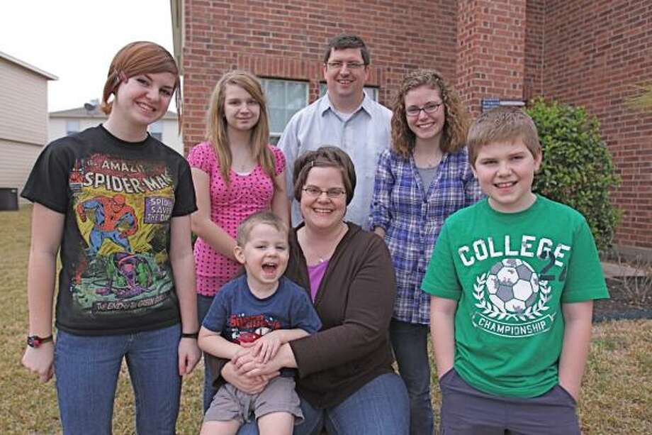 SUPPORTIVE FAMILY:  Stacey Nerdin works at home as a product tester and blogger. She hopes to launch a social media class for the community. Seated, Stacey, 37, holds Eli, 3. From left are, Maddy, 14; Abby, 12; Robb, 38; Hannah, 16; and Isaac, 9. Photo: Suzanne Rehak, For The Houston Chronicle