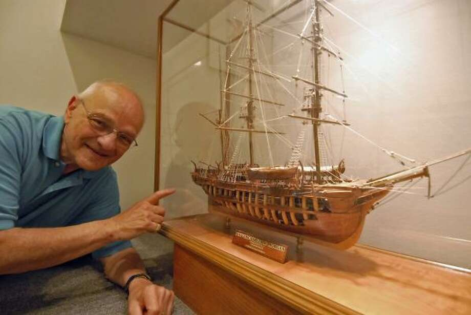 SHIP-SHAPE MODEL: Burt Reckles shows one of the model ships that adorn his home in Sugar Land. Photo: Tony Bullard, For The Chronicle
