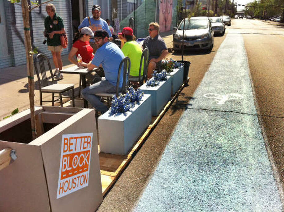 "Temporary bike lanes, sidewalk tables and chairs, live music and dance are part of a ""living workshop"" from 10 a.m. to 10 p.m. Saturday in Midtown. The free event, ""Hot Block on Holman,"" is headquartered at 1413 Holman. Photo: MELISSA PHILLIP, Houston Chronicle"