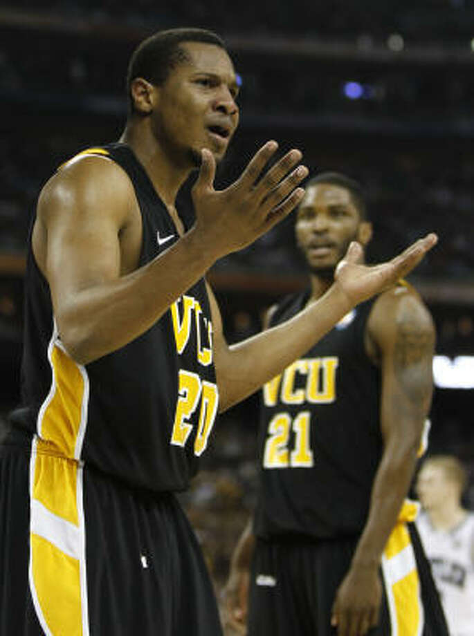 VCU's Bradford Burgess, left, shows his frustration as the Rams struggle to keep pace with Butler in the second half Saturday night. Photo: Nick De La Torre, Chronicle