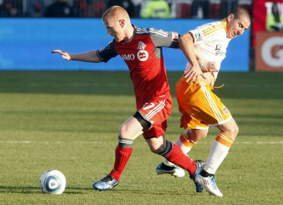 Koke, right, debuted for the Dynamo in Toronto and played with a teammate's shoes that were a size too small. Photo: Abelimages, Getty