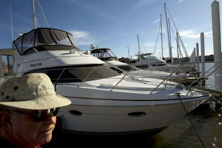 """Marine insurance salesman Niels Daugbjerg had this to say as he looked over yachts at the Waterford Harbor in Kemah last week:  """"If people go to Florida now or somewhere else to buy a boat, that's money Texas won't see."""" Photo: Johnny Hanson, Chronicle"""