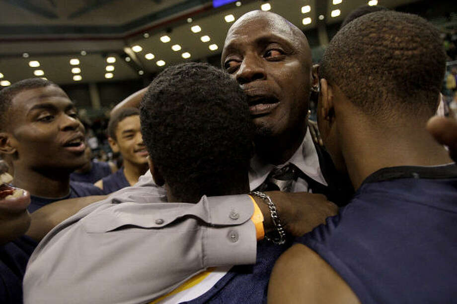 La Marque head coach Cedric Mason hugs some of his players after Saturday's win over Ball. Photo: Thomas B. Shea, For The Chronicle