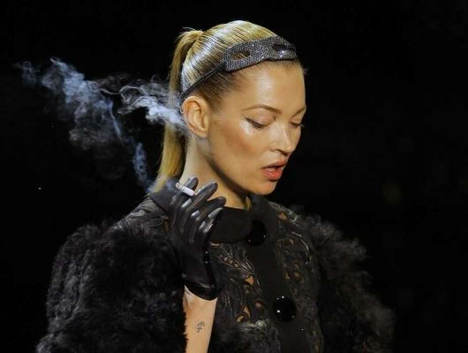 British model Kate Moss caused a stir at a recent Louis Vuitton fashion show when she walked down the runway puffing on a cigarette. Photo: Jacques Brinon, Associated Press