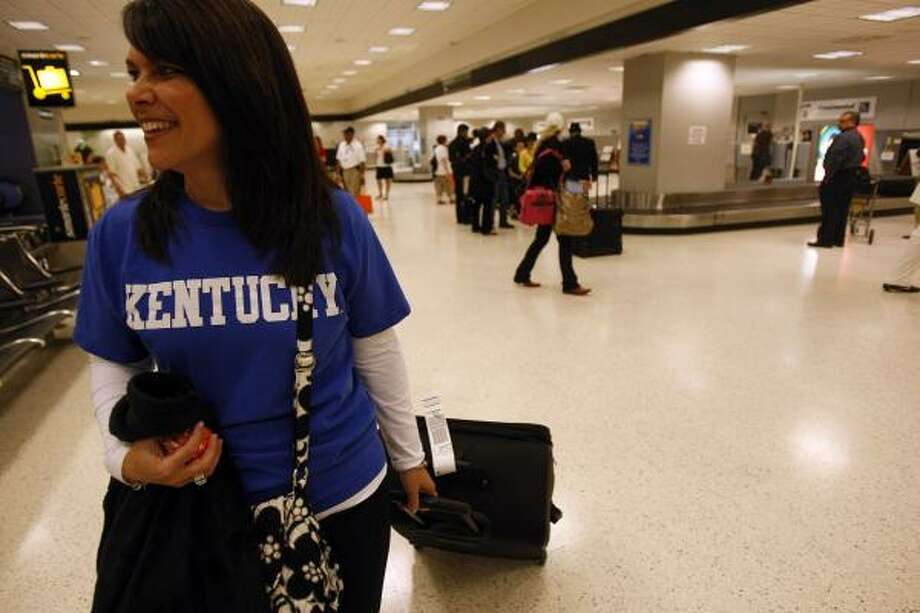 University of Kentucky graduate Julie Renner flew into Bush airport from Cincinnati to cheer on her team. Photo: Johnny Hanson, Chronicle