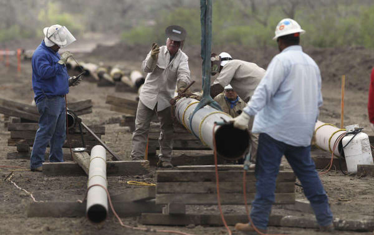 Welding crews are busy laying pipelines such as this one east of Karnes City in order to get oil and natural gas extracted from the Eagle Ford shale to market. Pipelines are critical because hauling by truck is more expensive.