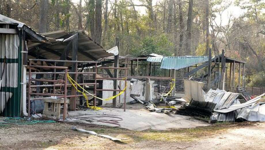DAVID HOPPER: FOR THE CHRONICLE BARN BLAZE: A fire destroyed the College Park/The Woodlands High School FFA ag barn last week. Photo: David Hopper, For The Chronicle