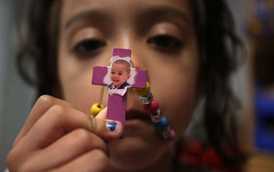 Kiyanna Richardson, 5, keeps a photo of her 3-year-old brother, Shomari, who died in the west Houston day-care fire in February. Photo: Mayra Beltran, Chronicle