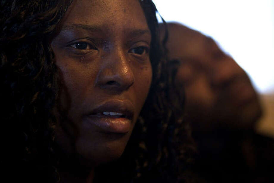 Betty Ukera says her husband, Emmanuel Kajoh, and her faith in God will carry her through after losing their 19-month-old daughter, Elizabeth, to the fire at Jackie's Child Care. Photo: Johnny Hanson, Houston Chronicle