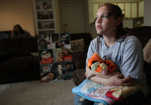Just 16 months old when he died, Elias Castillo had a favorite stuffed toy and a baby blanket that his grieving mother, Keshia Brown, holds tightly along with her memories. Photo: Mayra Beltran, Chronicle