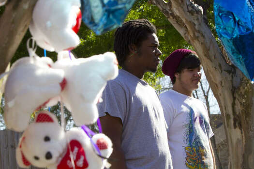 John Chestnut, 19, left, and Geoffrey DeShano, 18, called 9-1-1 and tried to help when smoke began pouring from Jackie's Child Care, but their rescue efforts were in vain. Photo: Brett Coomer, Chronicle