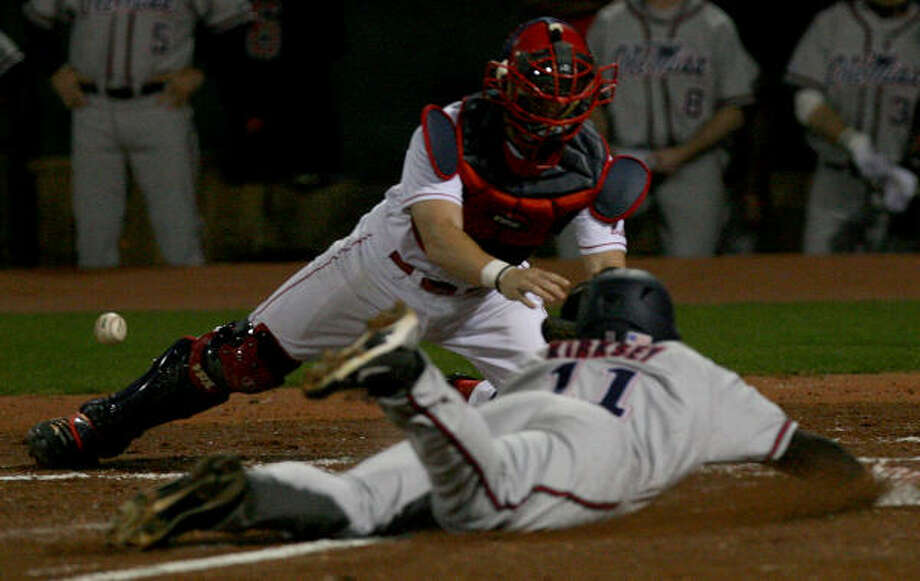 UH catcher John Cannon can't hold onto the ball as Ole Miss' Zach Kirksey scores on a play at the plate in the second inning. Photo: Thomas B. Shea, For The Chronicle