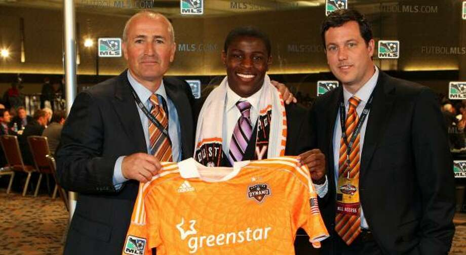 Dynamo coach Dom Kinnear, left, may have found his right back of the future in first-round draft pick Kofi Sarkodie. Photo: Ned Dishman, Getty Images