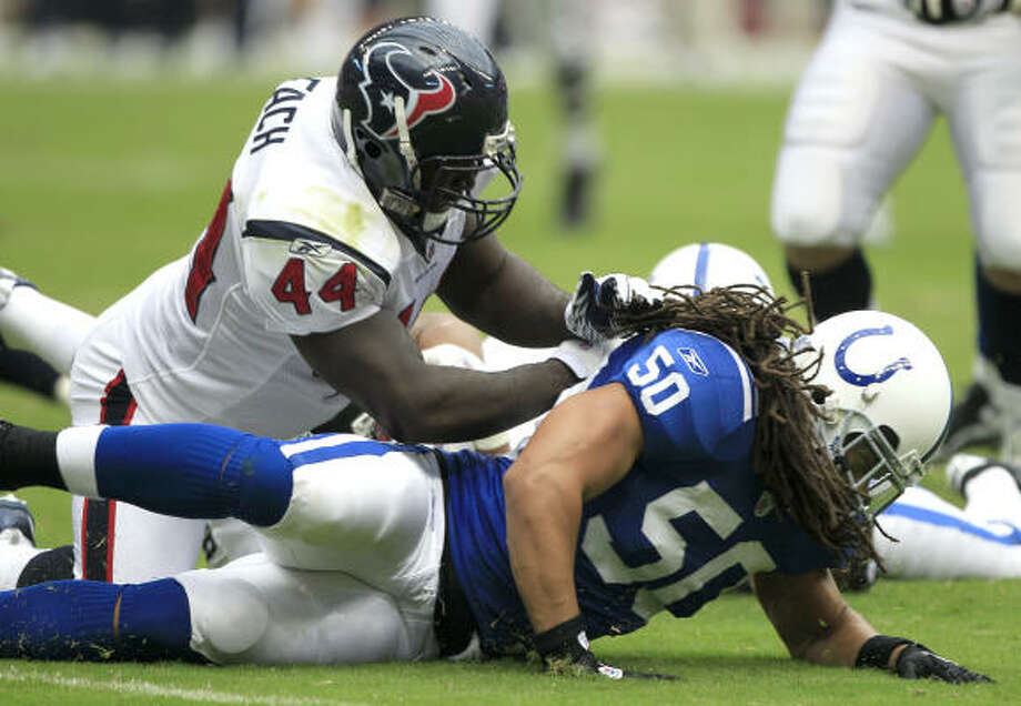 Texans fullback Vonta Leach blasts Colts linebacker Philip Wheeler. Leach's stellar blocking paved the way to an All-Pro year for running back Arian Foster and himself. Photo: Brett Coomer, Chronicle