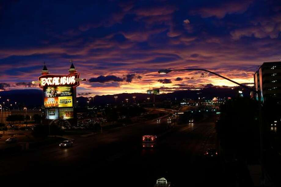 The Excalibur sign starts to shine as the sun sets over the strip in Las Vegas/ Photo: Keri Wiginton