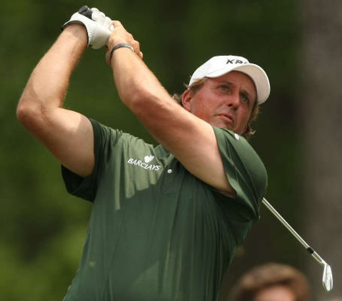 Phil Mickelson watches his tee shot on No. 14 during the third round of the Shell Houston Open.