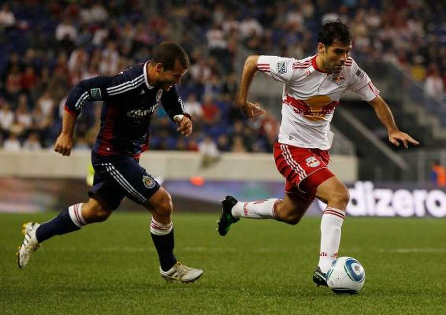 Rafa Marquez, right, is a key contributor for the New York Red Bulls and one of the biggest draws in MLS. Photo: Mike Stobe, Getty