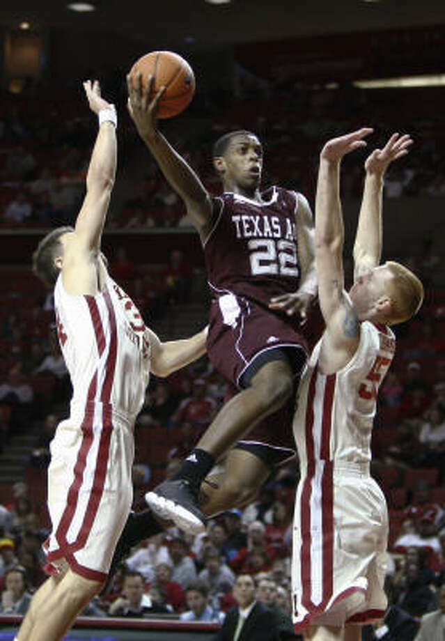 Forward Khris Middleton, center, leads Texas A&M in scoring with 14.7 points per game. Photo: Alonzo Adams, AP
