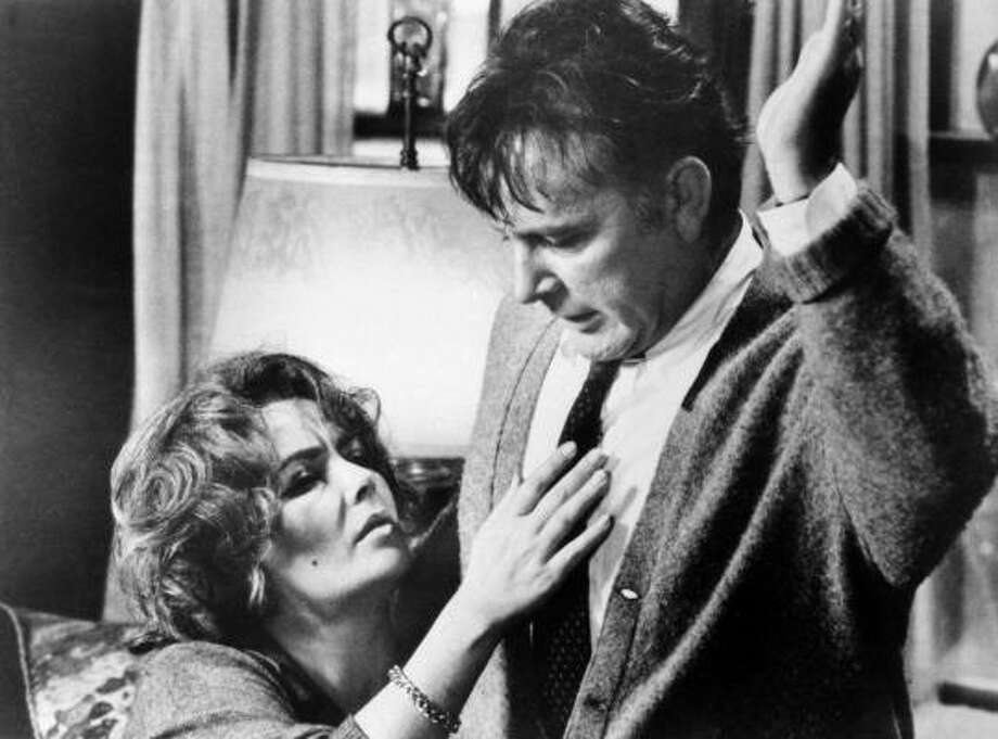 "Elizabeth Taylor in the role of Martha, and Richard Burton in the role of George in a scene from the 1966 movie ""Who's Afraid of Virginia Woolf?"" Photo: Associated Press"