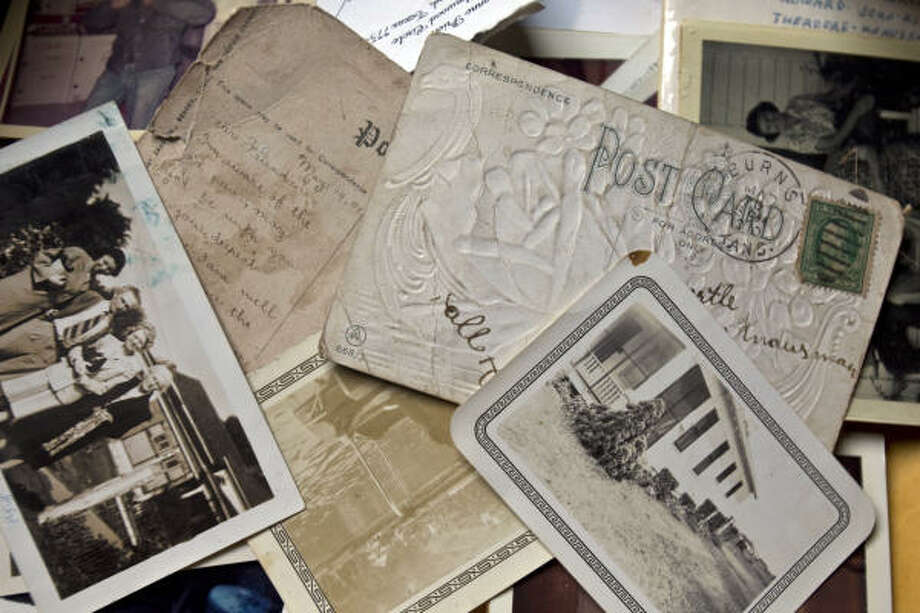 Old photos and postcards are among many items left by a previous owner of the 19th century Stringfellow Orchard home. Photo: Melissa Phillip, Chronicle