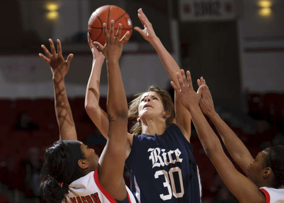 Rice's Jessica Kuster (30) shoots between Houston's Lesslee Mason, left, and Courtney Taylor. Photo: Bob Levey, For The Chronicle