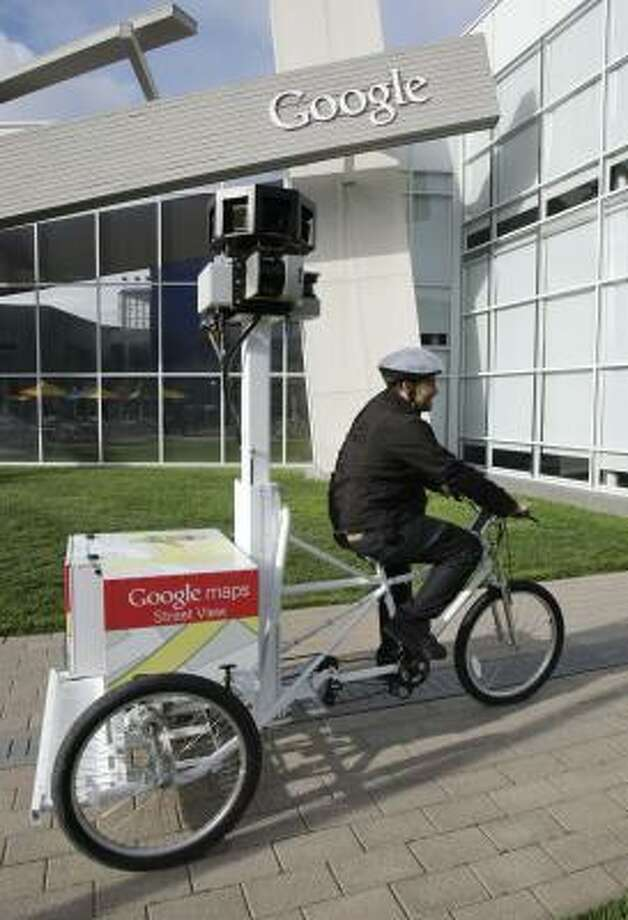 Matt Potter of Google pedals Goggle's new Street View Tricycle at Google headquarters in Mountain View, Calif. Photo: Paul Sakuma:, AP