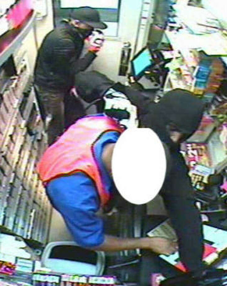 Surveillance footage shows the robbery at a gas station in the 4800 block of Texas 6 North. A worker, at left in the foreground, was injured in the attack. Photo: Crime Stoppers