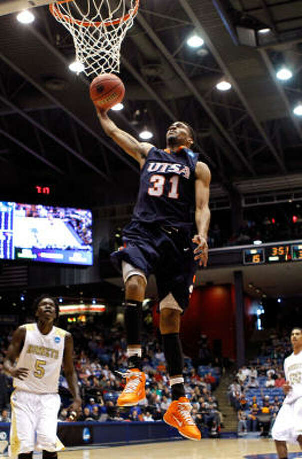 UTSA guard Melvin Johnson III soars toward the basket on his way to a dunk and two of his 29 points. Photo: Gregory Shamus, Getty Images