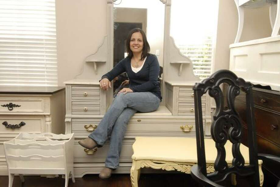 SIMPLE MATTERS: Jannet Howell works on refurbishing furniture at her home in Katy. Photo: Tony Bullard, For The Chronicle