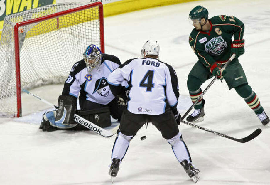 Aeros right wing Jon DiSalvatore, right, is unable to make a shot on Admirals goalie Jermey Smith during the first period. Photo: Mark Hoffman, Milwaukee Journal Sentinel