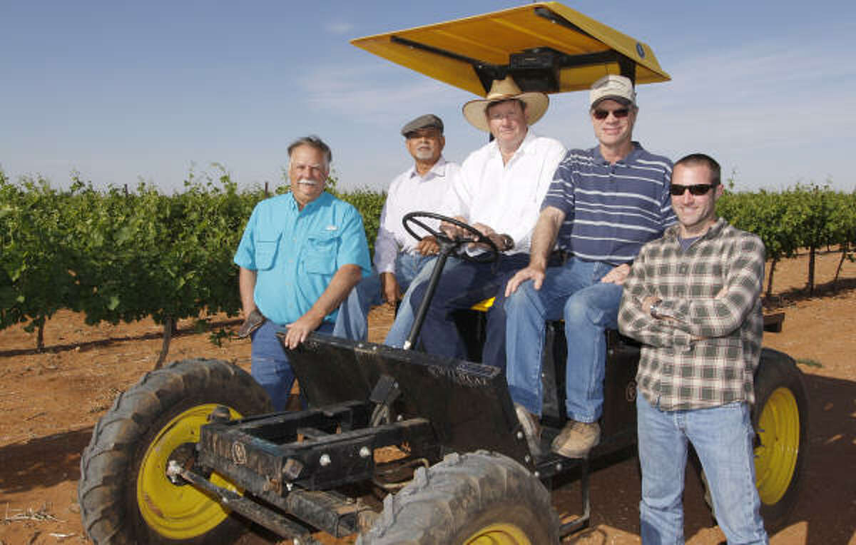 Bobby Cox, from left, has a vineyard in Ropesville; Vijay Reddy owns Reddy Vineyards outside of Brownfield; Neal Newsom has a vineyard in Plains; Cliff Bingham of Bingham Family Vineyards located west of Brownfield; and Dave Riley, winemaker for the Duchman Family Winery in Driftwood.