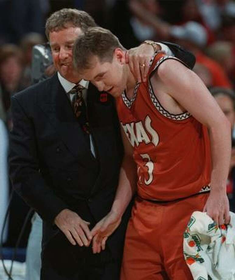 Texas coach Tom Penders celebrates a Longhorns victory over Oklahoma State with Brandy Perryman, one of his players, during the Big 12 Tournament in 1998. Photo: ORLIN WAGNER, AP